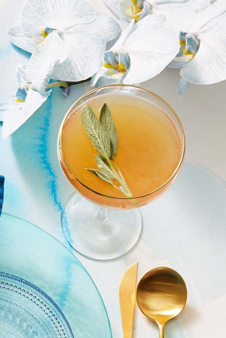 """<p>Break out the sage for this spicy cocktail! Have an absolutely haunted All Hallow's Eve with the addition of a frightfully fragrant herbal syrup.<br><br><em><a href=""""https://www.goodhousekeeping.com/food-recipes/a36890585/ginger-sage-rye-cocktail-recipe/"""" rel=""""nofollow noopener"""" target=""""_blank"""" data-ylk=""""slk:Get the recipe for Ginger-Sage Rye Cocktail »"""" class=""""link rapid-noclick-resp"""">Get the recipe for Ginger-Sage Rye Cocktail »</a></em><br></p>"""