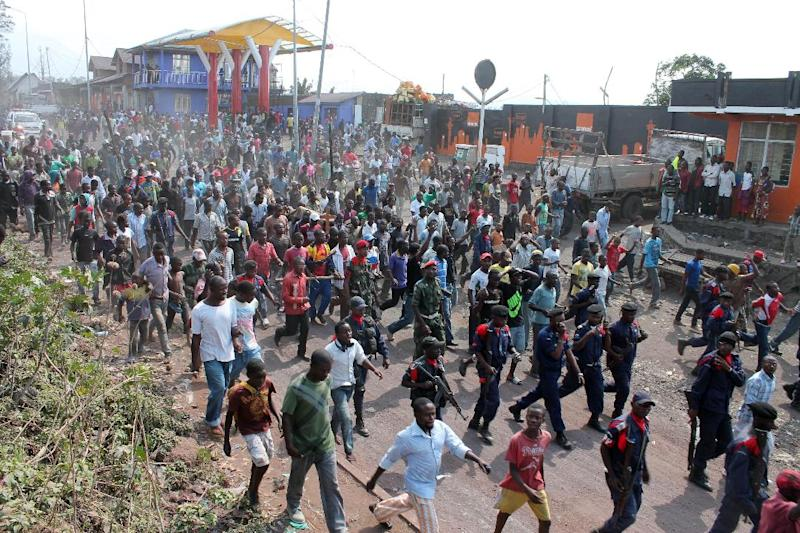 Residents march in protest over recent violence, in Goma, Congo, Saturday, Aug. 24, 2013. Congolese soldiers supported by U.N. forces fought rebels in the country's deteriorating east for hours early Saturday, officials said, while a rocket landed inside the town of Goma. Congo immediately blamed the attacks on neighboring Rwanda, which has long been accused of supporting the eastern Congolese rebel movement known as M23. (AP Photo/Alain Wandimoyi)