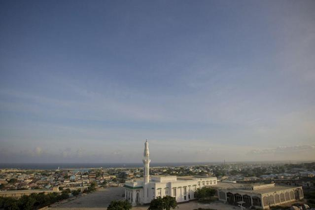 <p>MOGADISHU, SOMALIA: A handout photograph released by the African Union-United Nations Information Support Team, shows a general view of a mosque opposite the parliament building in the Somali capital Mogadishu.</p>