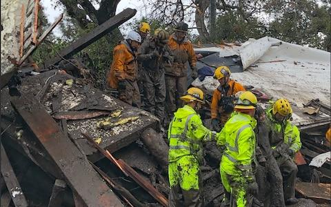 Californian Firefighters successfully rescued an unnamed 14-year-old girl - Credit: MIKE ELIASON/AFP