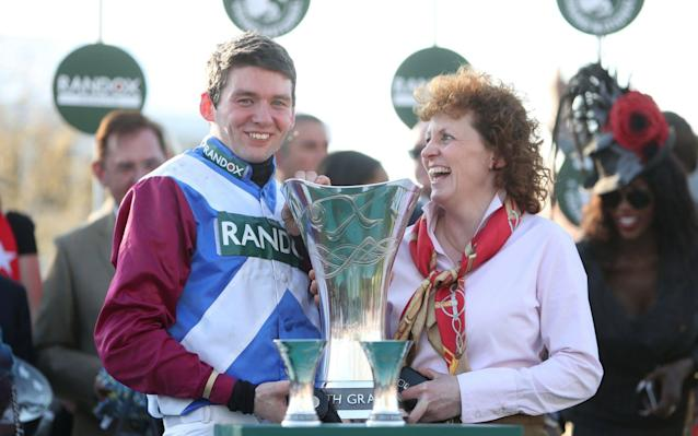 <span>Jockey Derek Fox and trainer Lucinda Russell celebrate with the trophy</span> <span>Credit: PA </span>