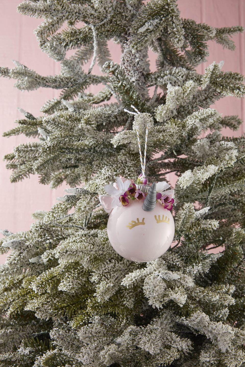 "<p>Delight the kids and grandkids with this sweet and friendly DIY unicorn ornament.</p><p><strong>To make:</strong> Remove the cap from a glass or plastic ball ornament. Lightly water down a small amount of light pink acrylic paint. Carefully pour the paint in the opening of the ornament. Rotate the ornament until the inside is fully covered with paint; pour out excess. Allow to dry then reattach cap. Press desired color sculpting clay into a silicone unicorn mold to create ears and horn; allow to dry completely. Attach a mini unicorn horn, ears, and fake flowers with hot glue. Draw eyelashes just below the horn with a gold paint pen.</p><p><a class=""link rapid-noclick-resp"" href=""https://www.amazon.com/Decorating-Fondant-Icing-Silicone-Mould/dp/B07G4CY7M6/ref=sr_1_6?tag=syn-yahoo-20&ascsubtag=%5Bartid%7C10050.g.1070%5Bsrc%7Cyahoo-us"" rel=""nofollow noopener"" target=""_blank"" data-ylk=""slk:SHOP UNICORN MOLD"">SHOP UNICORN MOLD</a></p>"