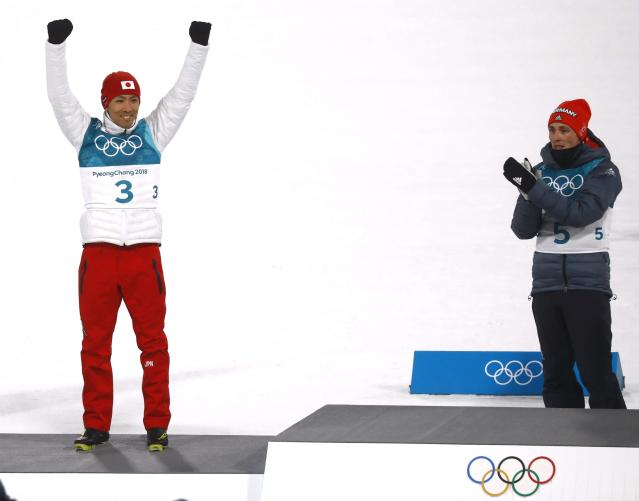 Nordic Combined Events - Pyeongchang 2018 Winter Olympics – Men's Individual 10km Final – Alpensia Cross-Country Skiing Centre - Pyeongchang, South Korea – February 14, 2018. Gold medalist Eric Frenzel of Germany and silver medalist Akito Watabe of Japan celebrate during the victory ceremony. REUTERS/Kai Pfaffenbach