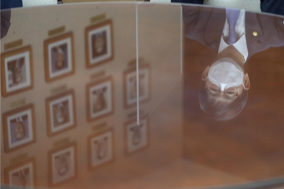 South Korea's Vice Defense Minister Park Jae-min is reflected in a table as he speaks during an interview at the Defense Ministry in Seoul, South Korea, Thursday, Aug. 26, 2021. South Korea's vice defense minister on Thursday called for North Korea to resume cooperation under a 2018 military agreement on reducing tensions, which Pyongyang has threatened to abandon over U.S.-South Korean military exercises. (AP Photo/Lee Jin-man)