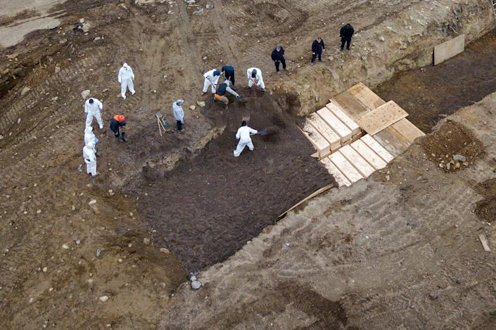 Bodies are buried on New York's Hart Island amid the coronavirus outbreak in New York City, on Apr. 9, 2020. | Lucas Jackson–REUTERS