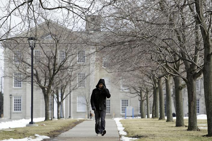 In this Wednesday, Feb. 15, 2012 photo, a person walks on the University at Buffalo campus in Buffalo, N.Y. The New York Police Department monitored Muslim college students far more broadly than previously known, at schools far beyond the city limits, including the University at Buffalo, the Ivy League colleges of Yale and the University of Pennsylvania, The Associated Press has learned. (AP Photo/David Duprey)