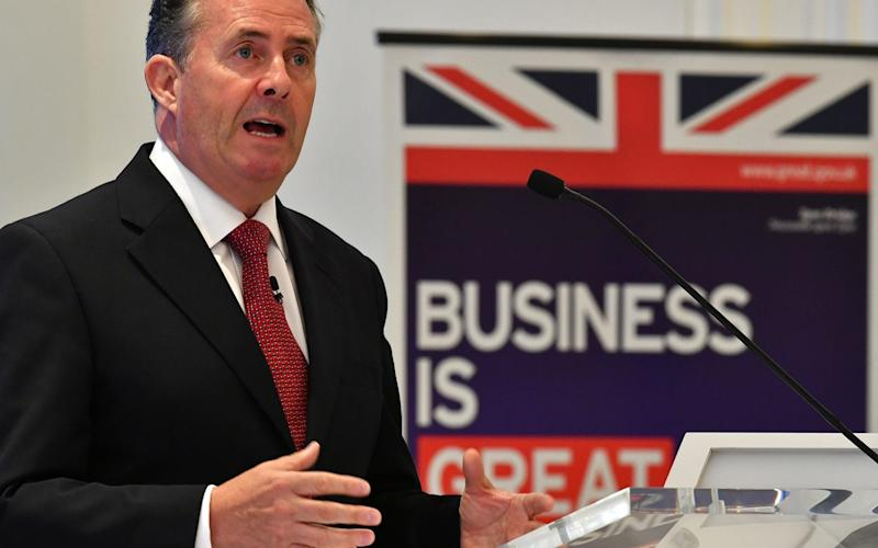 Liam Fox's department is racing to work out trade deals - AFP