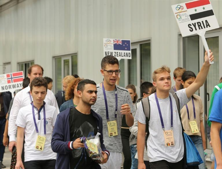 Hafez al-Assad (center), the son of Syrian President Bashar al-Assad who has been slapped with US sanctions, attends the International Maths Olympics in Cluj Napoca, Romania in 2018