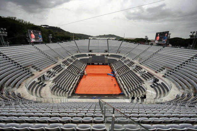 The central court is covered as all the matches are temporarily suspended due to the rain at the Italian Open tennis tournament in Rome, Wednesday, May 15, 2019. (Riccardo Antimiani/ANSA via AP)