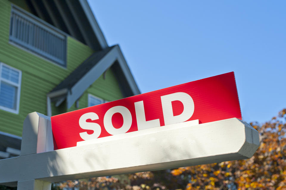 Sold sign outside house.