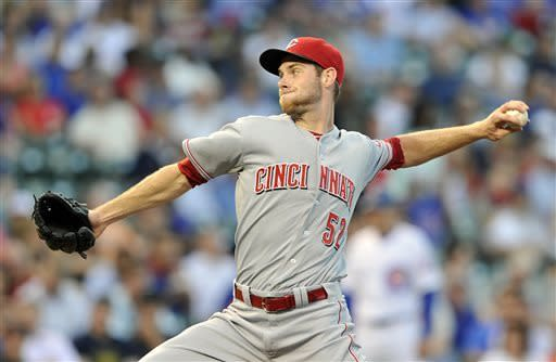 Cincinnati Reds' Tony Cingrani pitches against the Chicago Cubs during the first inning of a baseball game on Tuesday, June 11, 2013, in Chicago. (AP Photo/Jim Prisching)