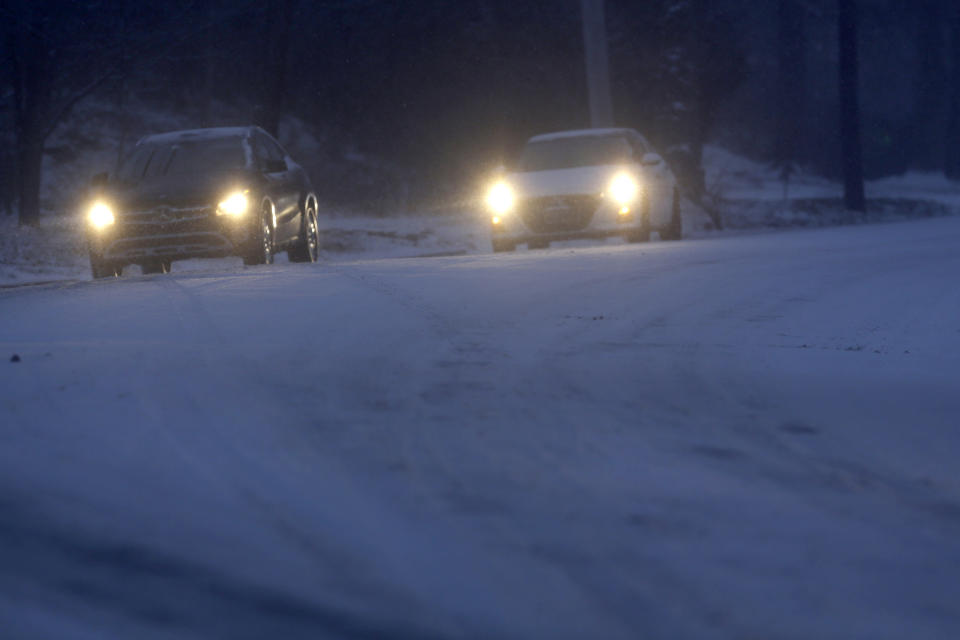 Motorists make their way along an icy road Sunday Jan. 31, 2021 in Philadelphia. After days of frigid temperatures, the Northeast is bracing for a whopper of a storm that could dump well over a foot of snow in many areas and create blizzard-like conditions. (AP Photo/Jacqueline Larma)