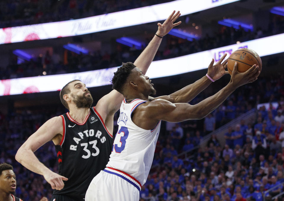 Philadelphia 76ers' Jimmy Butler, right, goes up for the shot against Toronto Raptors' Marc Gasol, left, during the second half of Game 3 of a second-round NBA basketball playoff series, Thursday, May 2, 2019, in Philadelphia. 76ers won 116-95. (AP Photo/Chris Szagola)
