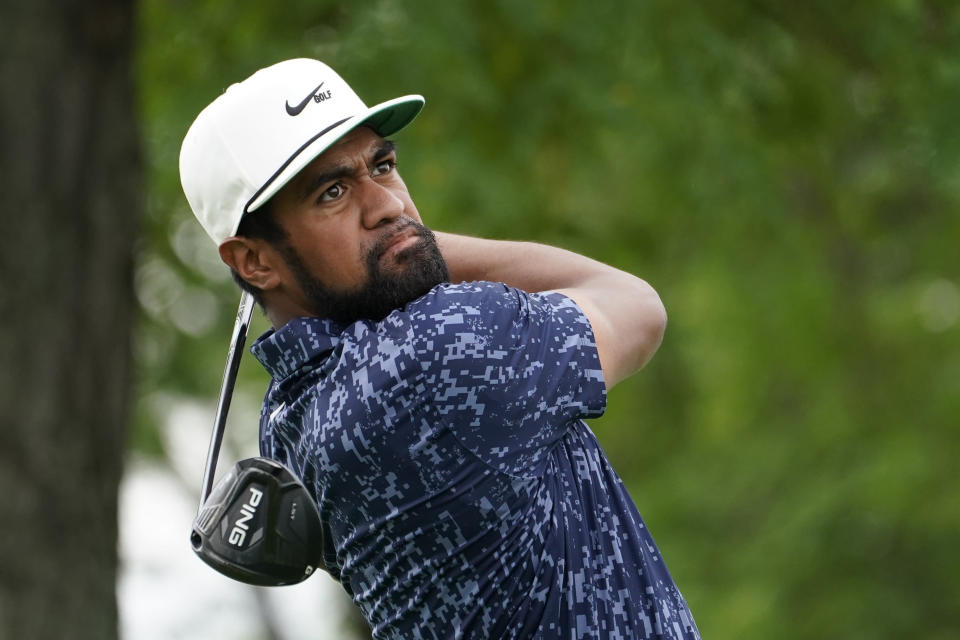 Tony Finau watches his shot from the 13th tee in the third round at the Northern Trust golf tournament, Saturday, Aug. 21, 2021, at Liberty National Golf Course in Jersey City, N.J. (AP Photo/John Minchillo)