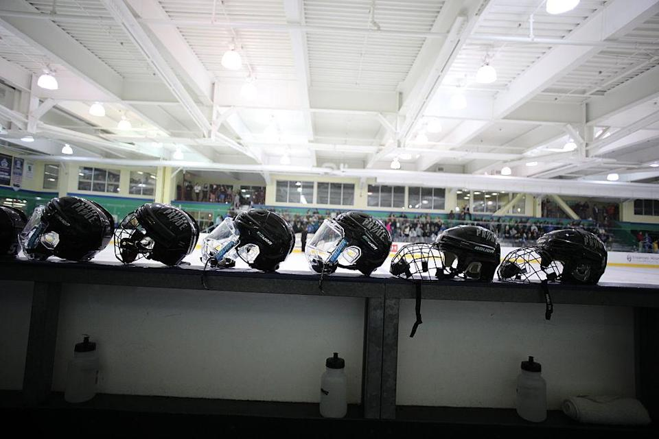 Helmets of Boston Pride players before the Connecticut Whale vs Boston Pride. National Women's Hockey League game at Chelsea Piers, Stamford, Connecticut, USA. 27th December 2015. Photo Tim Clayton (Photo by Tim Clayton/Corbis via Getty Images)