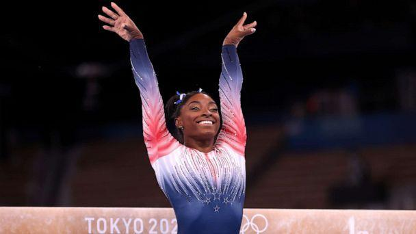 PHOTO: Simone Biles competes in the Women's Balance Beam Final on day eleven of the Tokyo 2020 Olympic Games at Ariake Gymnastics Centre on Aug. 3, 2021 in Tokyo. (Laurence Griffiths/Getty Images, FILE)