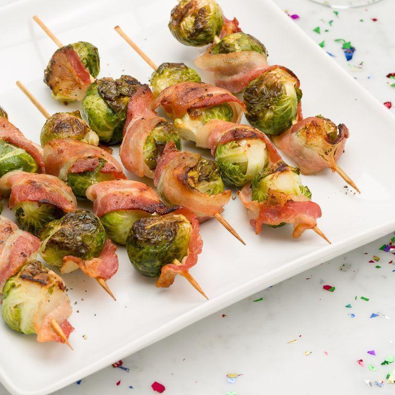 """<p>This impressive recipe calls for just two ingredients.</p><p>Get the <a href=""""https://www.delish.com/uk/cooking/recipes/a33859395/bacon-brussels-sprout-skewers/"""" rel=""""nofollow noopener"""" target=""""_blank"""" data-ylk=""""slk:Bacon Brussels Sprout Skewers"""" class=""""link rapid-noclick-resp"""">Bacon Brussels Sprout Skewers</a> recipe.</p>"""