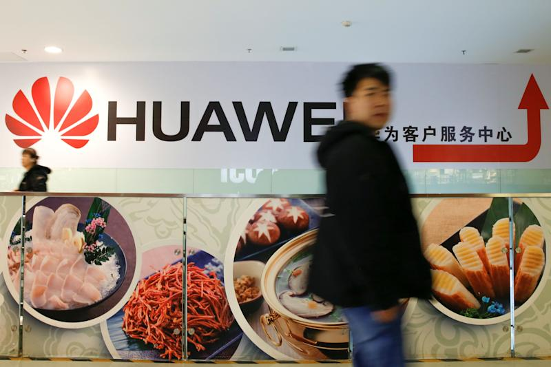 A man walks past a Huawei sign in a mall in Beijing, China, January 29, 2019. REUTERS/Thomas Peter