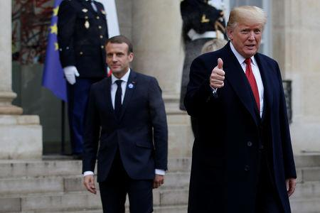 US President Donald Trump leaves after a meeting at the Elysee Palace on the eve of the commemoration ceremony for Armistice Day, 100 years after the end of the First World War, in Paris