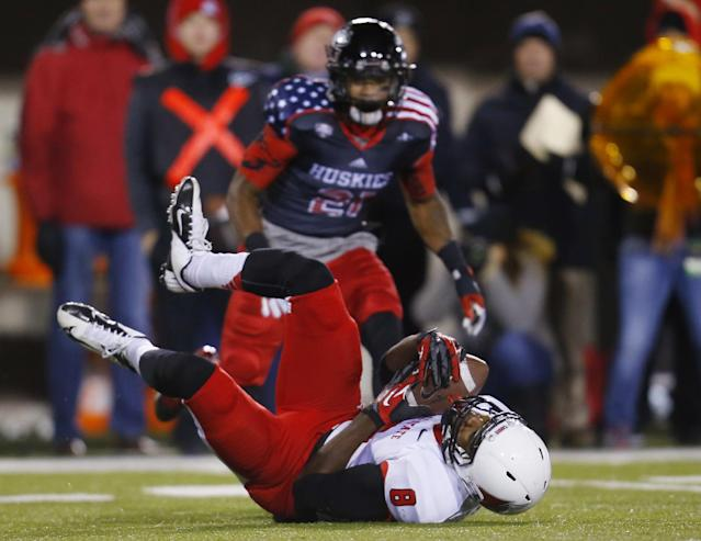 Ball State wide receiver Jordan Williams (8) makes a catch in front of Northern Illinois cornerback Marlon Moore (21) during the first half of an NCAA college football game Wednesday, Nov. 13, 2013, in DeKalb, Ill. (AP Photo/Jeff Haynes)