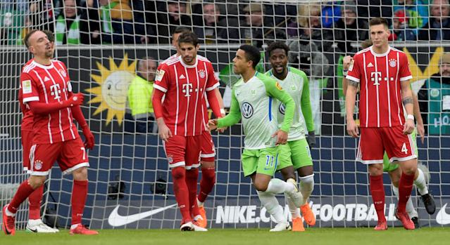 Soccer Football - Bundesliga - VfL Wolfsburg vs Bayern Munich - Volkswagen Arena, Wolfsburg, Germany - February 17, 2018 Wolfsburg's Daniel Didavi celebrates scoring their first goal with Divock Origi as Bayern Munich's Franck Ribery and team mates look dejected REUTERS/Fabian Bimmer DFL RULES TO LIMIT THE ONLINE USAGE DURING MATCH TIME TO 15 PICTURES PER GAME. IMAGE SEQUENCES TO SIMULATE VIDEO IS NOT ALLOWED AT ANY TIME. FOR FURTHER QUERIES PLEASE CONTACT DFL DIRECTLY AT + 49 69 650050