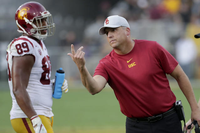 Southern California head coach Clay Helton motions to an official during the second half of an NCAA college football game against Arizona State, Saturday, Nov. 9, 2019, in Tempe, Ariz. (AP Photo/Matt York)