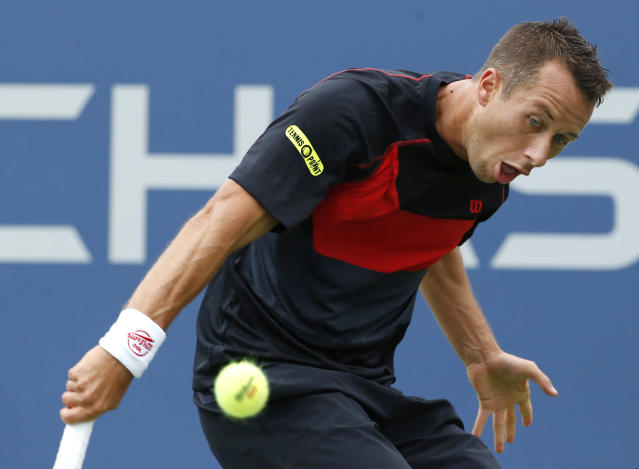 Philipp Kohlschreiber, of Germany, returns a shot against John Isner, of the United States, during the third round of the 2014 U.S. Open tennis tournament, Saturday, Aug. 30, 2014, in New York. (AP Photo/Kathy Willens)