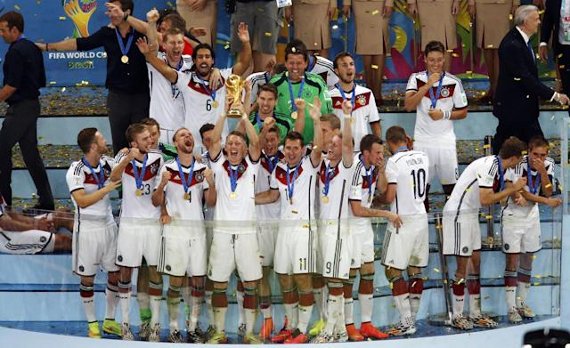 Germany team celebrate after winning the World Cup final soccer match between Germany and Argentina at the Maracana Stadium in Rio de Janeiro, Brazil, Sunday, July 13, 2014. Mario Goetze volleyed in the winning goal in extra time to give Germany its fourth World Cup title with a 1-0 victory over Argentina on Sunday. (AP Photo/Fabrizio Bensch, Pool)