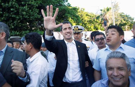 Venezuelan opposition leader Juan Guaido, who many nations have recognized as the country's rightful interim ruler, gestures after a meeting with Ecuador's President Lenin Moreno in Salinas