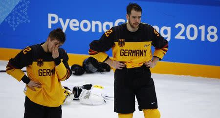 Ice Hockey - Pyeongchang 2018 Winter Olympics - Men's Final Game - Olympic Athletes from Russia v Germany - Gangneung Hockey Centre, Gangneung, South Korea - February 25, 2018 - Brooks Macek and Marcel Noebels of Germany react after their overtime loss. REUTERS/Brian Snyder
