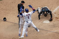 New York Mets' Javier Baez celebrates with Jonathan Villar after scoring the game winning run past Miami Marlins catcher Alex Jackson during the ninth inning of the first game of a baseball doubleheader that started April 11 and was suspended because of rain, Tuesday, Aug. 31, 2021, in New York. The Mets won 6-5. (AP Photo/Adam Hunger)