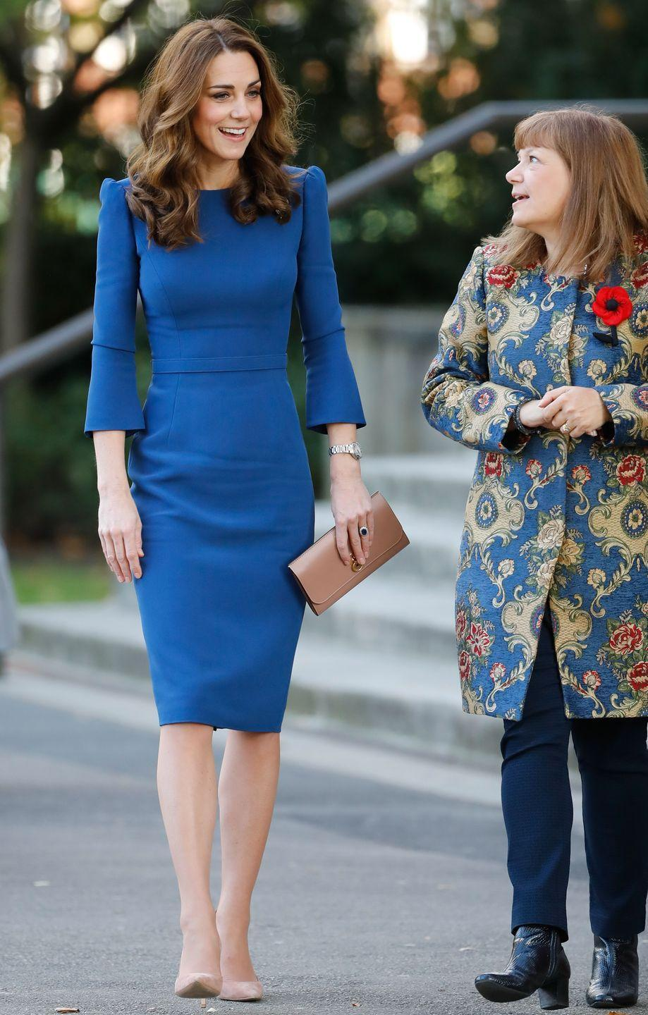 """<p>The Duchess stepped out <a href=""""https://www.townandcountrymag.com/society/tradition/a24477283/kate-middleton-blue-jenny-packham-dress-imperial-war-museum-photo/"""" rel=""""nofollow noopener"""" target=""""_blank"""" data-ylk=""""slk:for a visit to the Imperial War Museum"""" class=""""link rapid-noclick-resp"""">for a visit to the Imperial War Museum</a> in London. Kate wore a rich blue dress by Jenny Packham with a clutch and nude heels. </p>"""