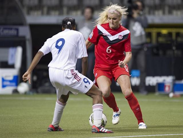 VANCOUVER, CANADA - JANUARY 21: Kaylyn Kyle #6 of Canada tries to get around Dayanay Baro #9 of Cuba during the second half of the 2012 CONCACAF Women's Olympic Qualifying Tournament at BC Place on January 21, 2012 in Vancouver, British Columbia, Canada. (Photo by Rich Lam/Getty Images)