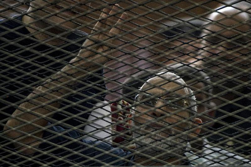 Egyptian Muslim Brotherhood leader Mohamed Badie gestures as he shouts from inside the defendants cage during his trial in Cairo, on June 7, 2014