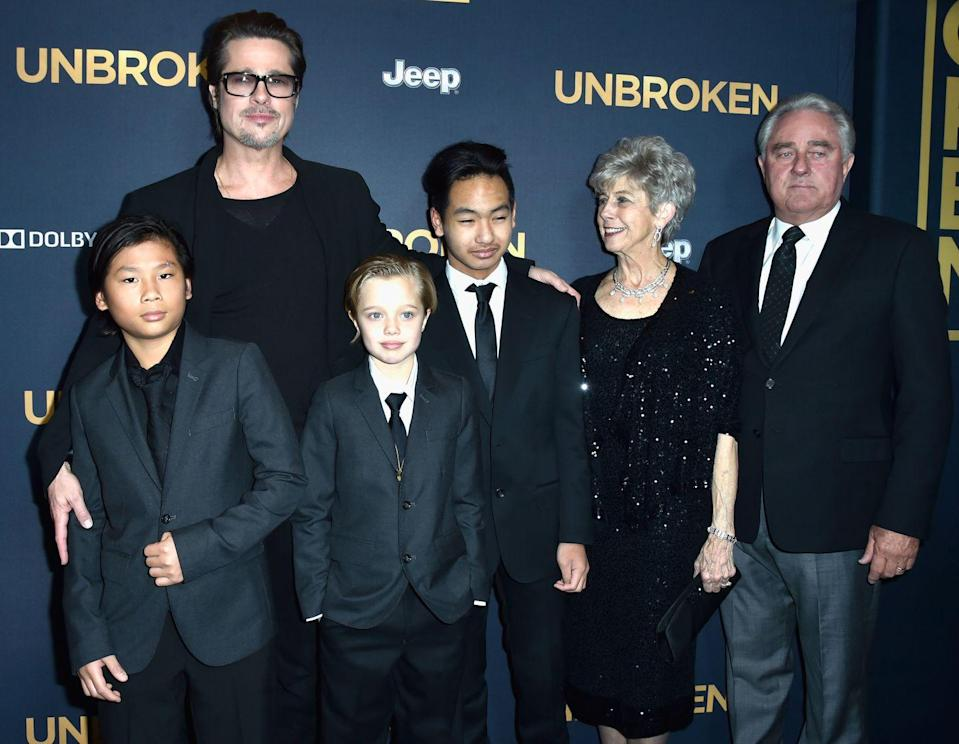 <p>Pitt is escorted by three of his children, Pax, Shiloh, and Maddox, as well as his parents, Jane and William Pitt, to the premiere of <em>Unbroken</em>. The film was directed by Pitt's then-wife, Angelina Jolie.</p>