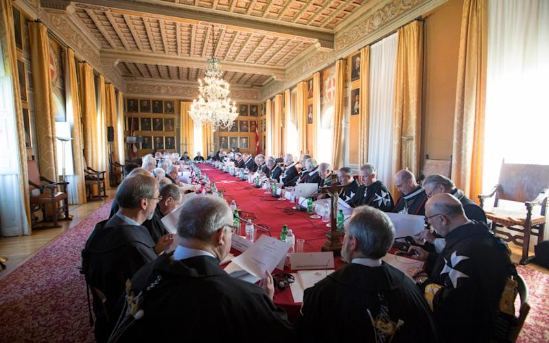 Knights of Malta take part in the secret ballot for a new Grand Master at the order's Villa Magistrale in Rome - Credit: Remo Casilli/Malta Knights via AP