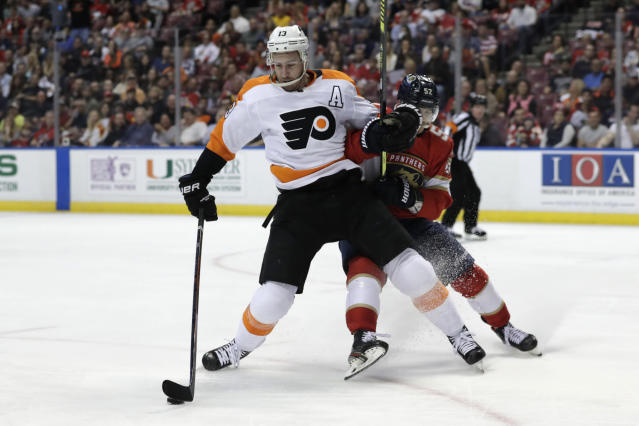 Philadelphia Flyers center Kevin Hayes (13) skates with the puck as Florida Panthers defenseman MacKenzie Weegar defends during the second period of an NHL hockey game Thursday, Feb. 13, 2020, in Sunrise, Fla. (AP Photo/Lynne Sladky)