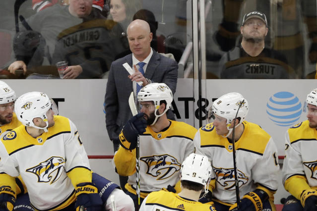FILE - In this Jan. 9, 2020, file photo, Nashville Predators head coach John Hynes, center top, talks to his team during the first period of an NHL hockey game against the Chicago Blackhawks in Chicago. Hynes has only been head coach of the Predators since Jan. 7, so he is trying to make up for some lost time with the NHL paused for the coronavirus pandemic and also make sure they are ready whenever hockey resumes. (AP Photo/Nam Y. Huh, File)