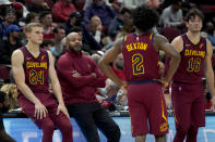 Cleveland Cavaliers head coach Bernie Bickerstaff talks with Lauri Markkanen (24), Collin Sexton (2) and Cedi Osman during the second half of an NBA preseason basketball game Tuesday, Oct. 5, 2021, in Chicago. (AP Photo/Charles Rex Arbogast)