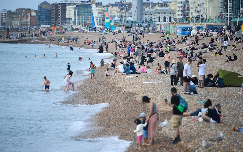 Beachgoers in Brighton this afternoon - Kirsty O'Connor/PA Wire