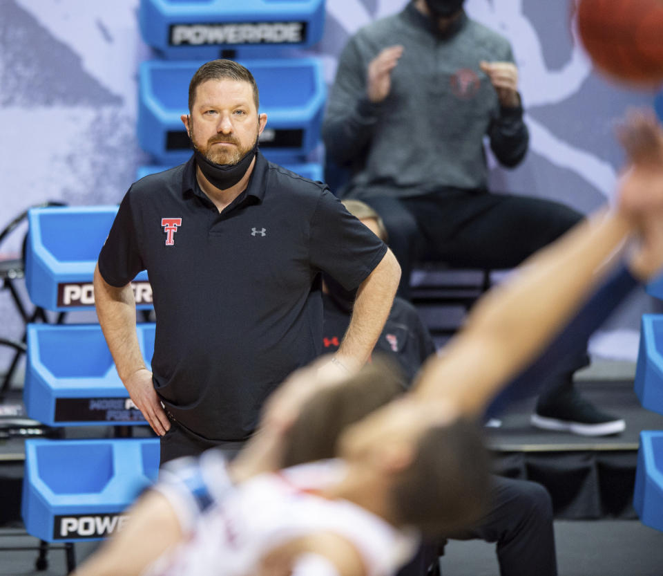 Texas Tech head coach Chris Beard watches the action on the court from the sideline during the first half of a first round game against Utah State in the NCAA men's college basketball tournament, Friday, March 19, 2021, in Bloomington, Ind. (AP Photo/Doug McSchooler)