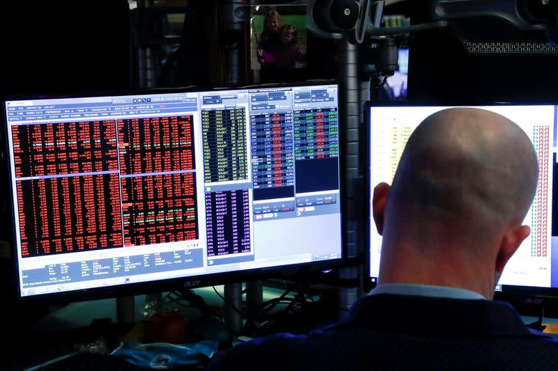 Wall Street tumbles on rising virus cases, grim economic forecast