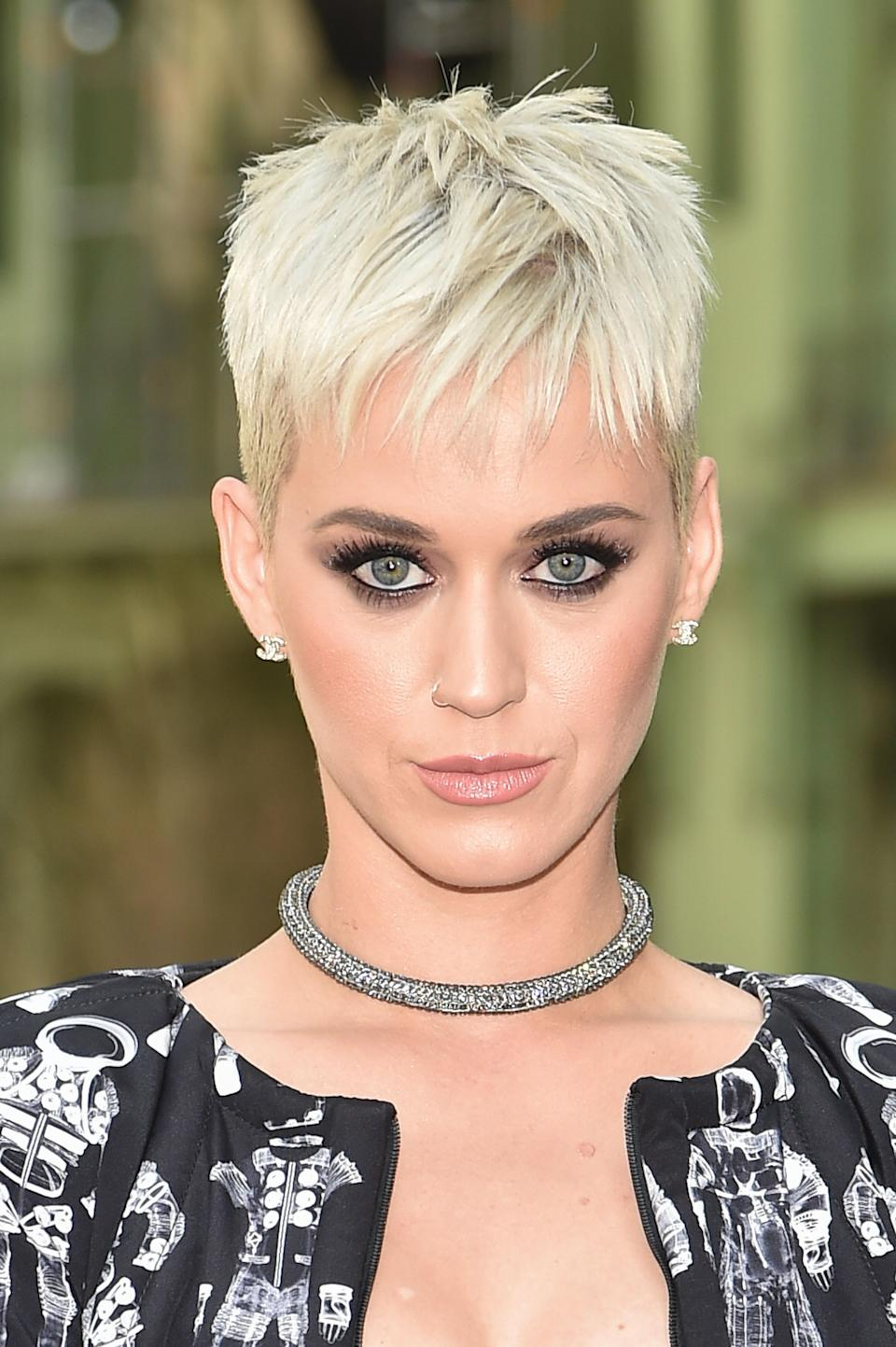 "Perry's platinum crop <a href=""https://www.glamour.com/story/katy-perry-ellen-platinum-pixie-reveal?mbid=synd_yahoo_rss"" rel=""nofollow noopener"" target=""_blank"" data-ylk=""slk:may not have been her original plan"" class=""link rapid-noclick-resp"">may not have been her original plan</a>, but it suits her so well."