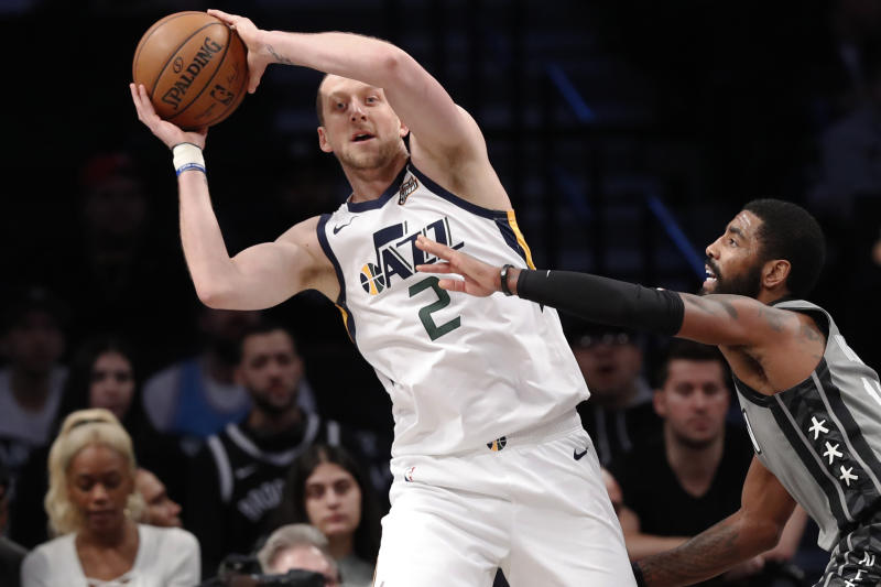 Utah Jazz forward Joe Ingles (2) looks to pass the ball as Brooklyn Nets guard Kyrie Irving, right, defends during the first quarter of an NBA basketball game Tuesday, Jan. 14, 2020, in New York. (AP Photo/Kathy Willens)