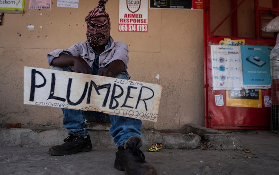 South Africa: An unemployed plumber advertises for work in Lenasia South, Johannesburg - AP
