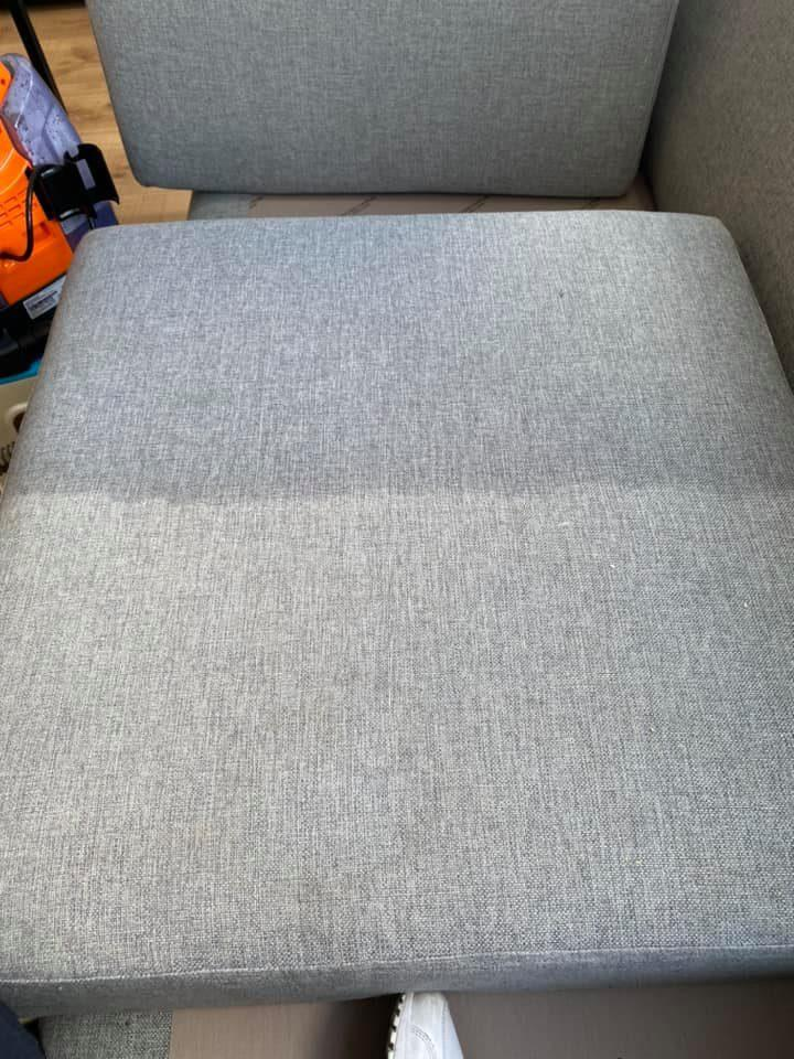 Image of couch cushion one half deep grey and clean, the other light and dirty Bissel before and after