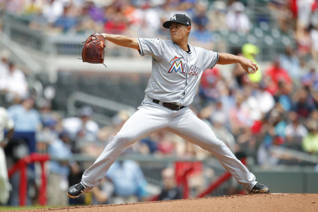 Miami Marlins starting pitcher Wei-Yin Chen delivers in the first inning of a baseball game against the Miami Marlins, Sunday, May 20, 2018, in Atlanta. (AP Photo/Todd Kirkland)
