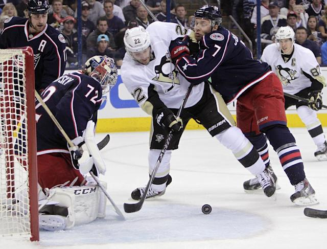 Columbus Blue Jackets' Sergei Bobrovsky (72), of Russia, makes a save as teammate Jack Johnson, right, tries to clear Pittsburgh Penguins' Lee Stempniak from in front of the net during the first period of a first-round NHL playoff hockey game Monday, April 21, 2014, in Columbus, Ohio. (AP Photo/Jay LaPrete)