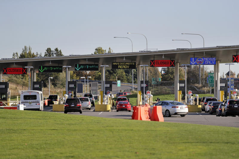 In this photo taken Oct. 9, 2019, traffic enters the United States from Canada at the Peace Arch Border Crossing, in Blaine, Wash. Civil rights groups and lawmakers were demanding information from federal officials following reports that dozens of Iranian-Americans were held up and questioned at the border as they returned to the United States from Canada over the weekend. (AP Photo/Elaine Thompson)