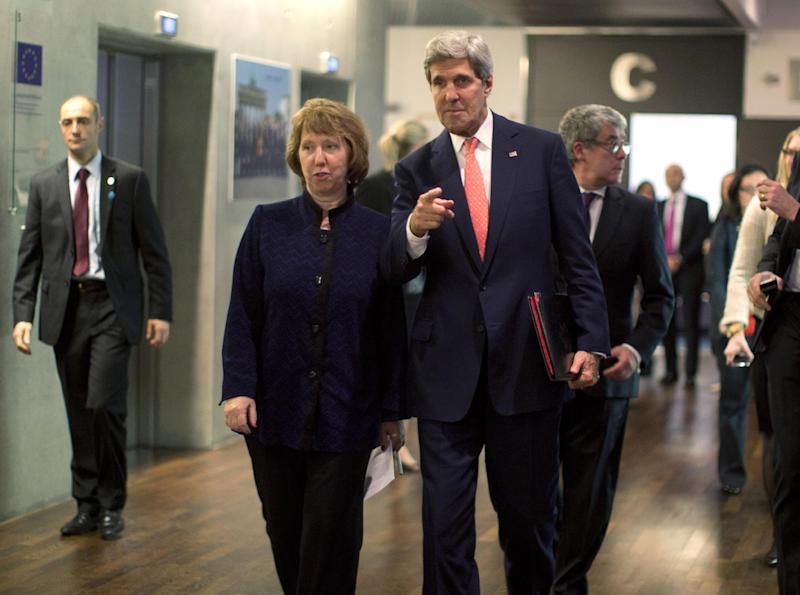 U.S. Secretary of State John Kerry walks with European Union foreign policy chief Catherine Ashton before their meeting with Iranian Foreign Minister Mohammad Javad Zarif in Geneva, Friday Nov. 8, 2013. (AP Photo/Jason Reed, Pool)